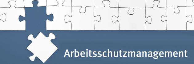 """Ein Puzzleteil liegt vor der dazugehörigen Lücke im Puzzle, dazu der Schriftzug """"Arbeitsschutzmanagement"""""""